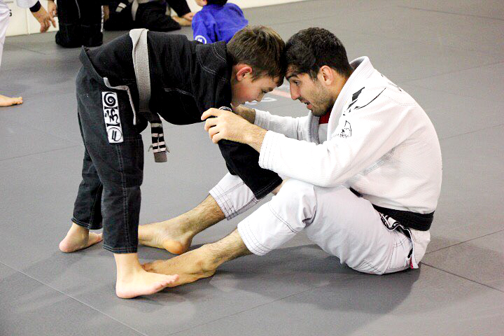 brazilian jiu jitsu child with instructor lucas lepri