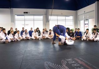 Lucas Lepri teaching a technique to adult class